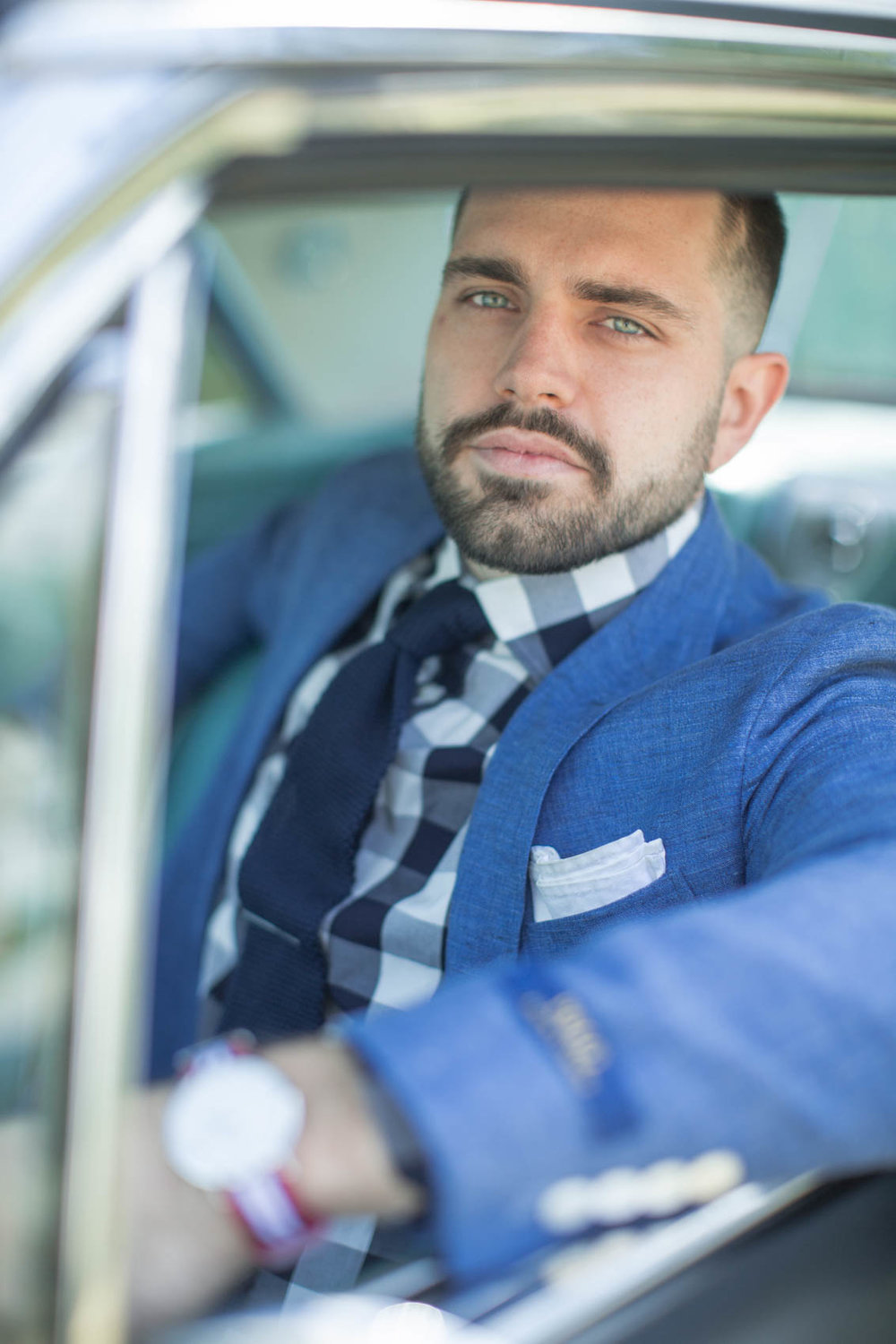 Male in gingham shirt with sport coat and pocket square