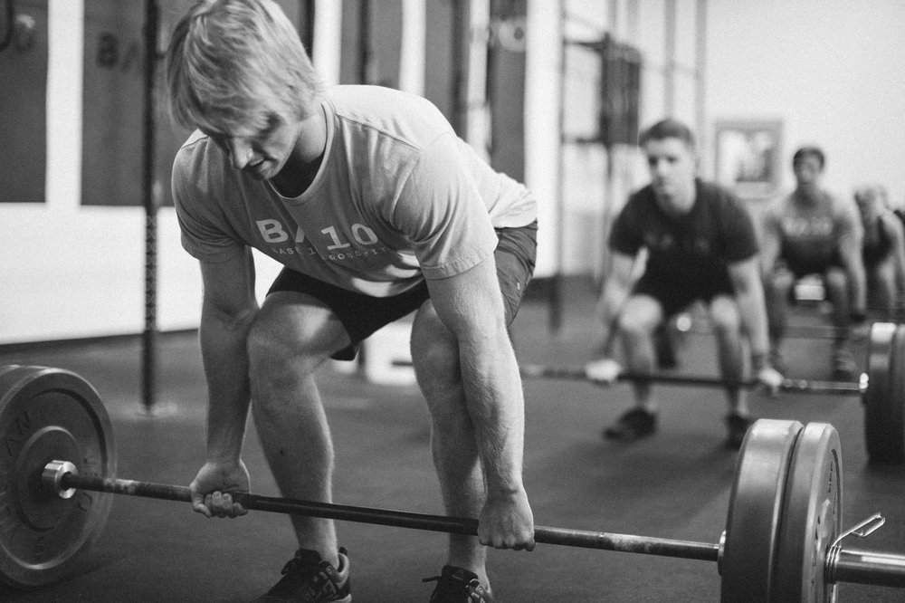 Personal training deadlifts in gym