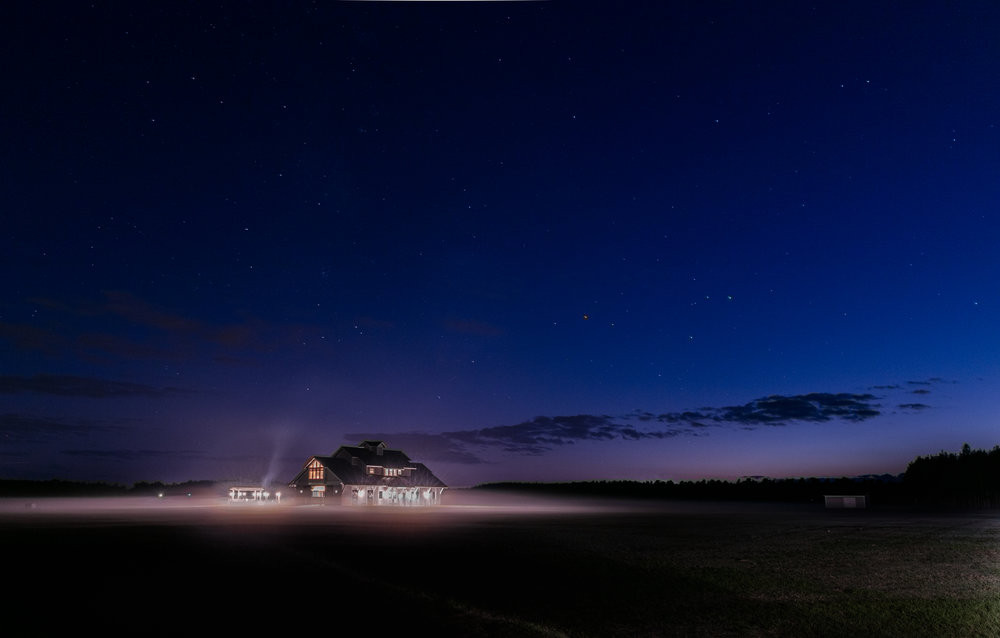 Residential farmhouse exterior photography at night