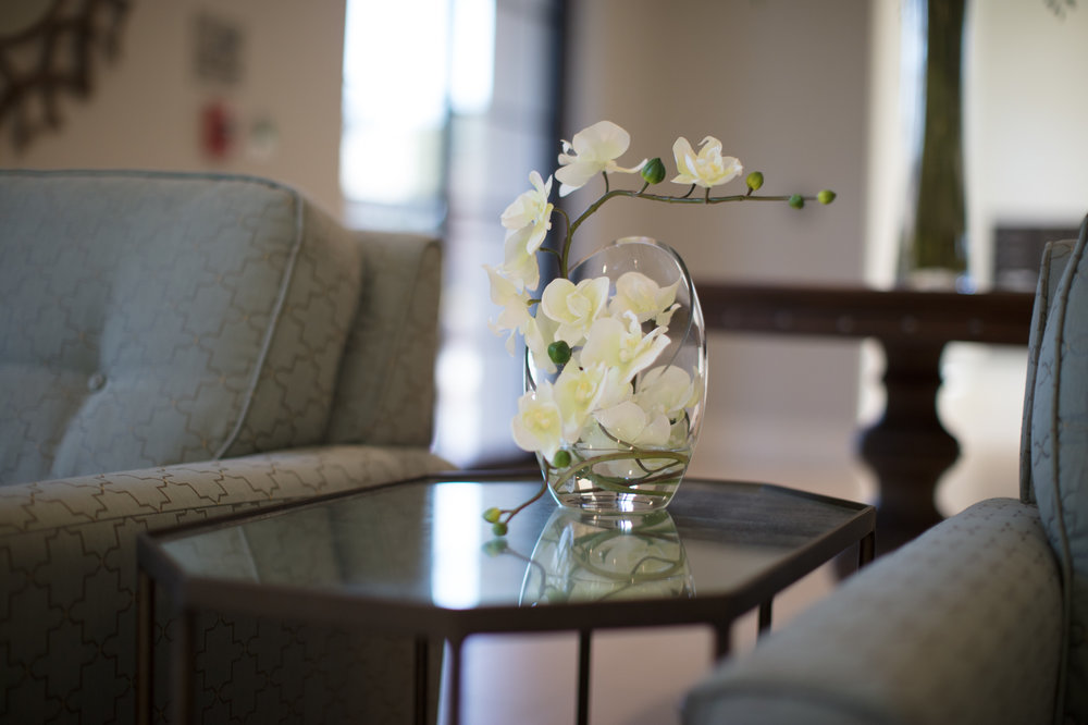 Table centerpiece with flower in vase at senior living facility