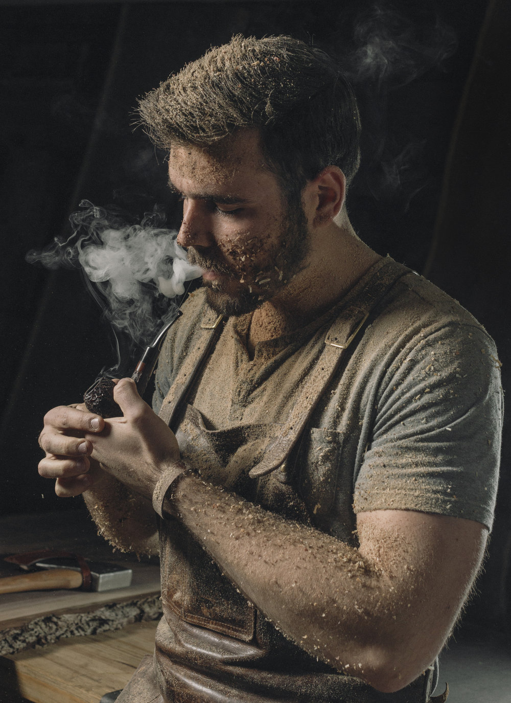 Artisan woodworker smoking pipe portrait