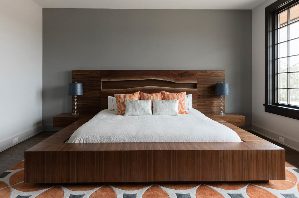 Custom wooden bed frame in modern bedroom
