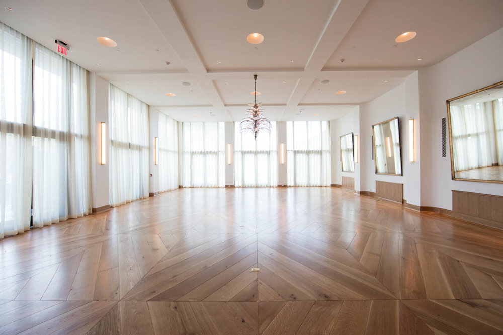 White hotel ballroom with wood floors