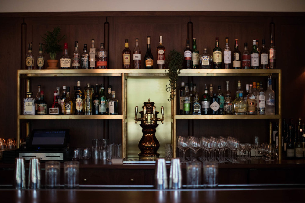 Vintage bar with glasses and liquor bottles