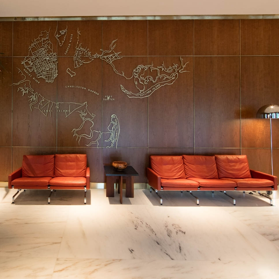 Hotel front lobby with orange leather couches