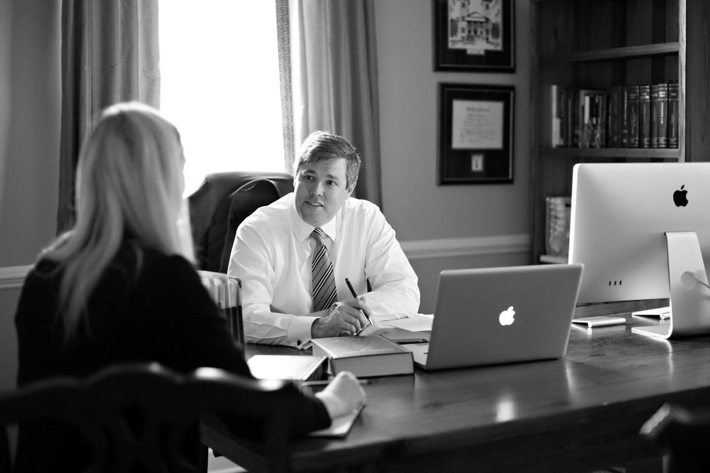 Black and white portrait of lawyer in office