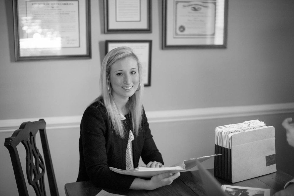Black and white portrait of female lawyer in office