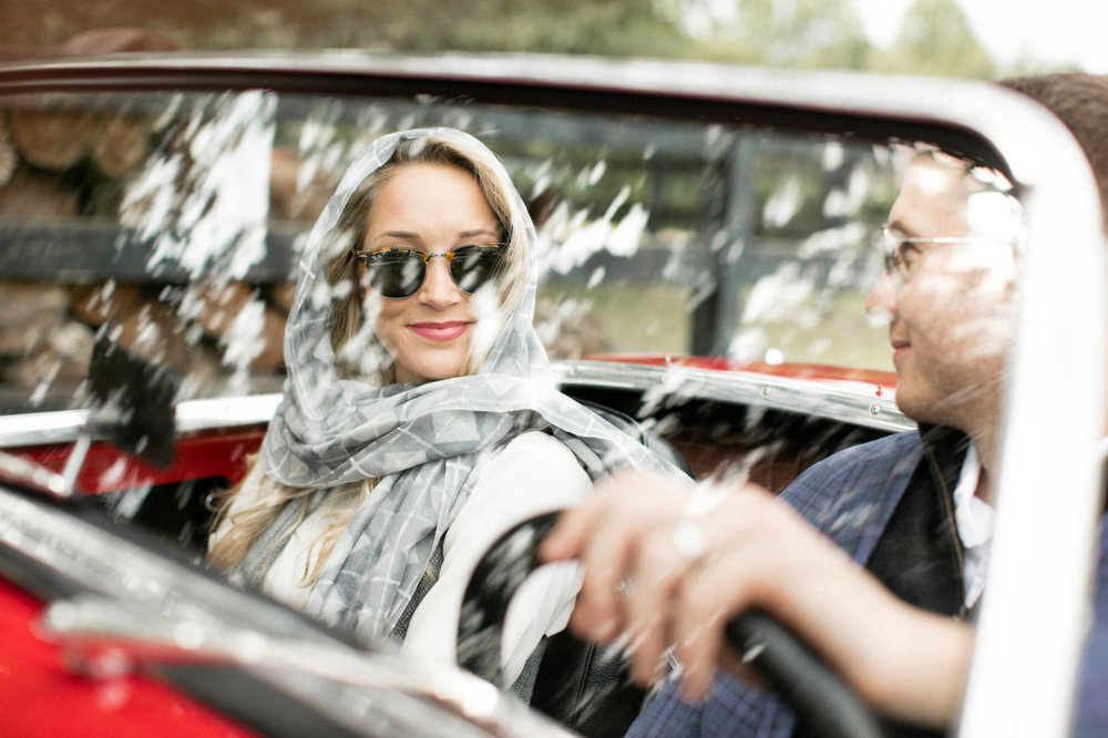 Vintage red convertible with female with a headscarf