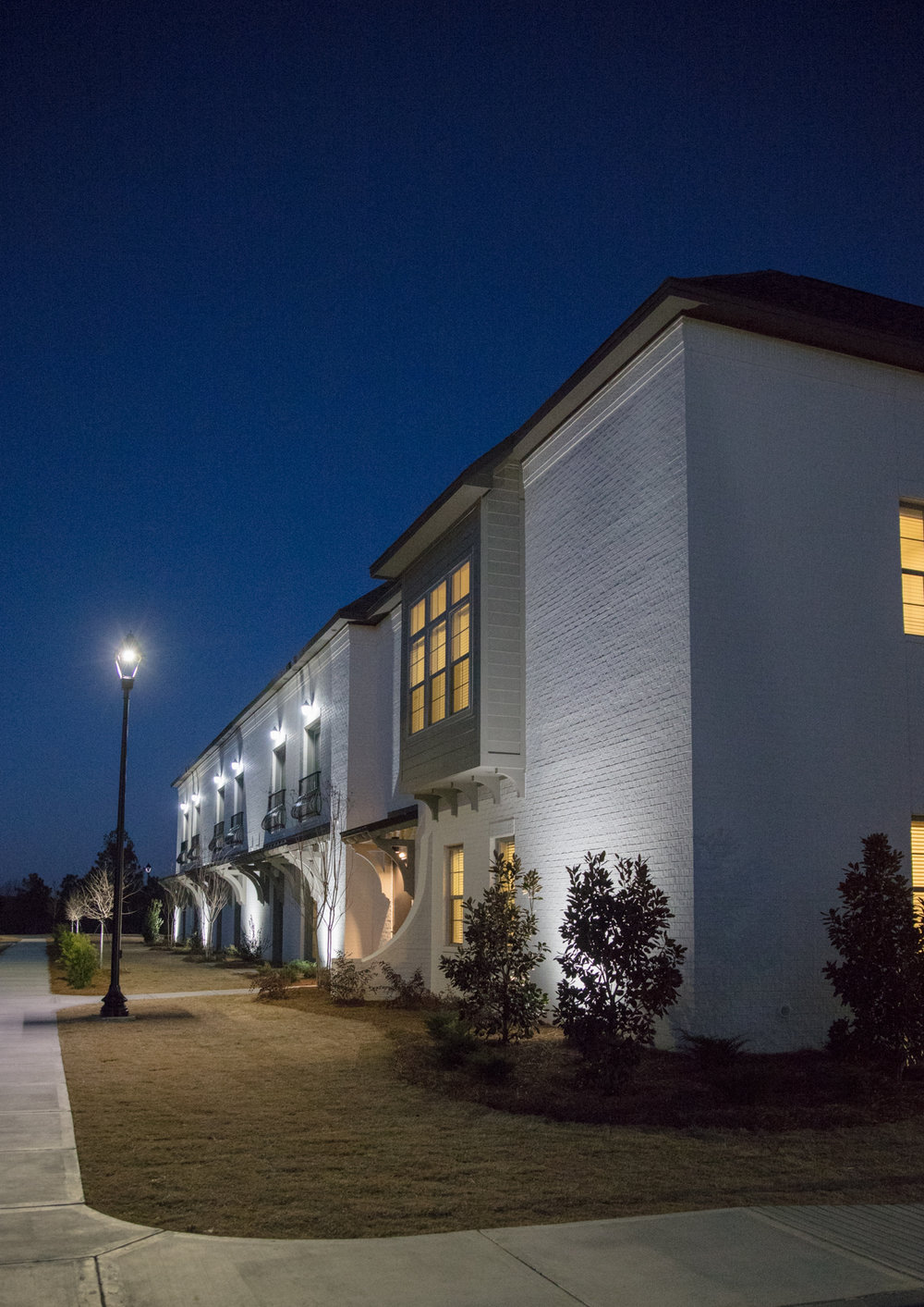 Senior assisted living building exterior at night