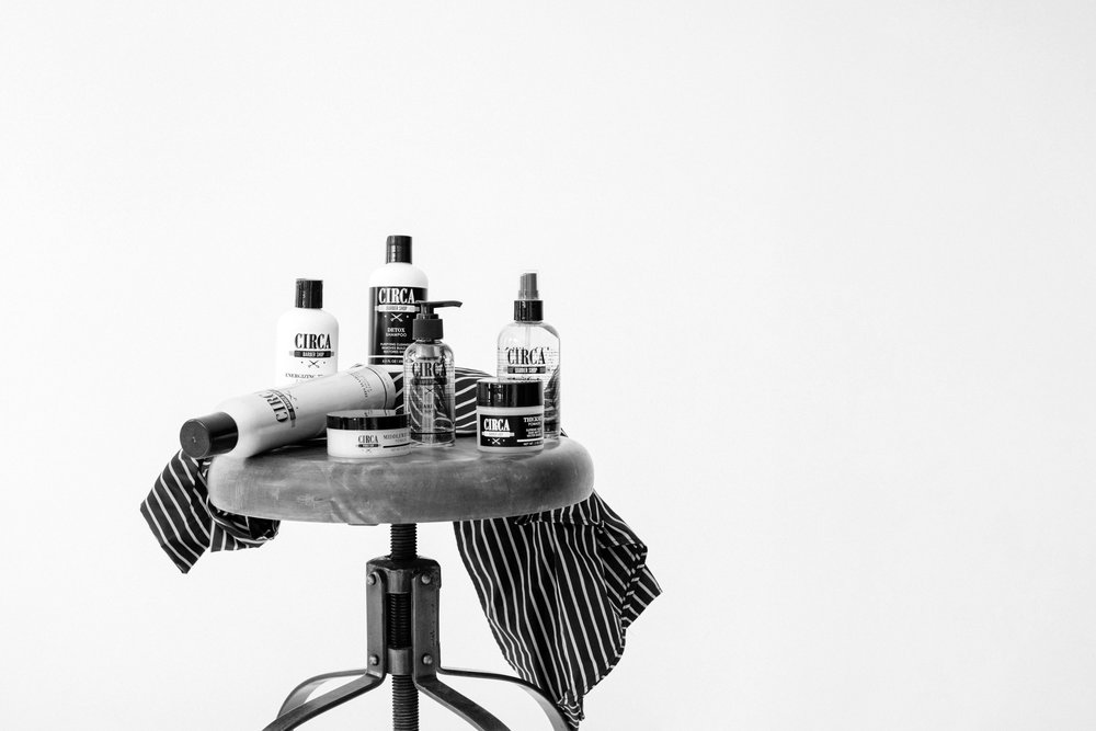 barbershop styled products on stool