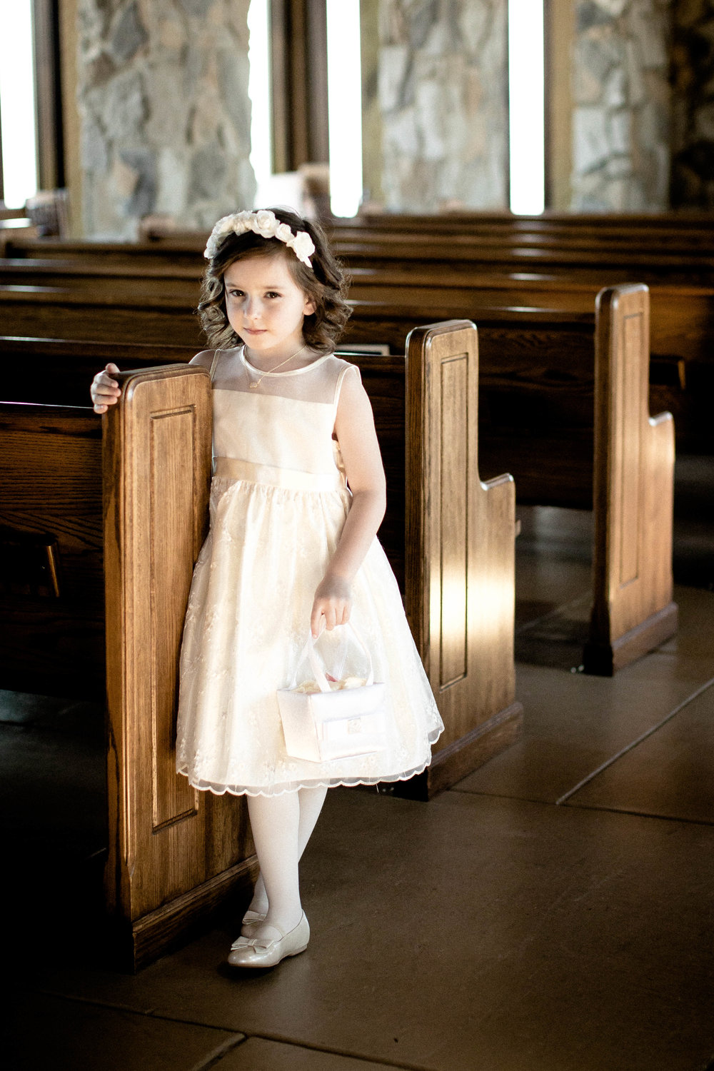 Wedding photography flower girl in chapel