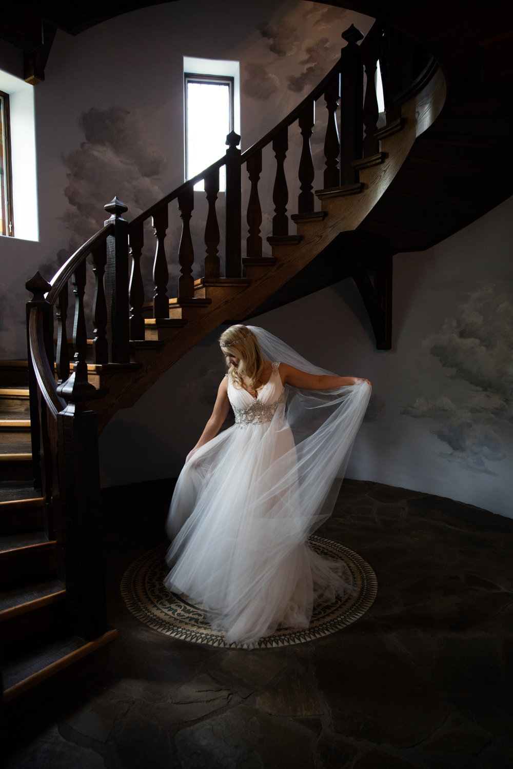 Wedding photography bridal portrait long veil staircase castle wedding