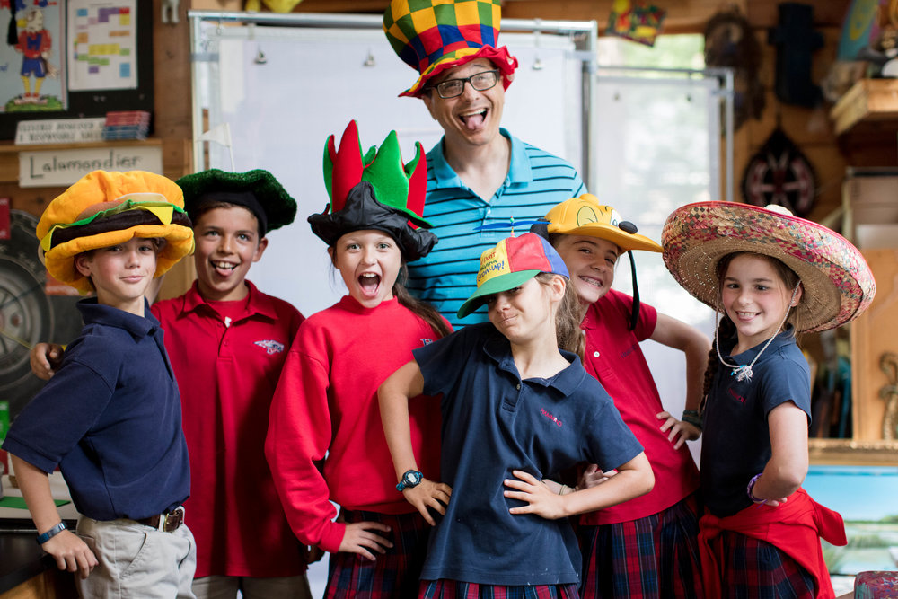 Students and teacher with funny hats