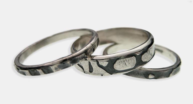 Tafoni patterned Silver rings.