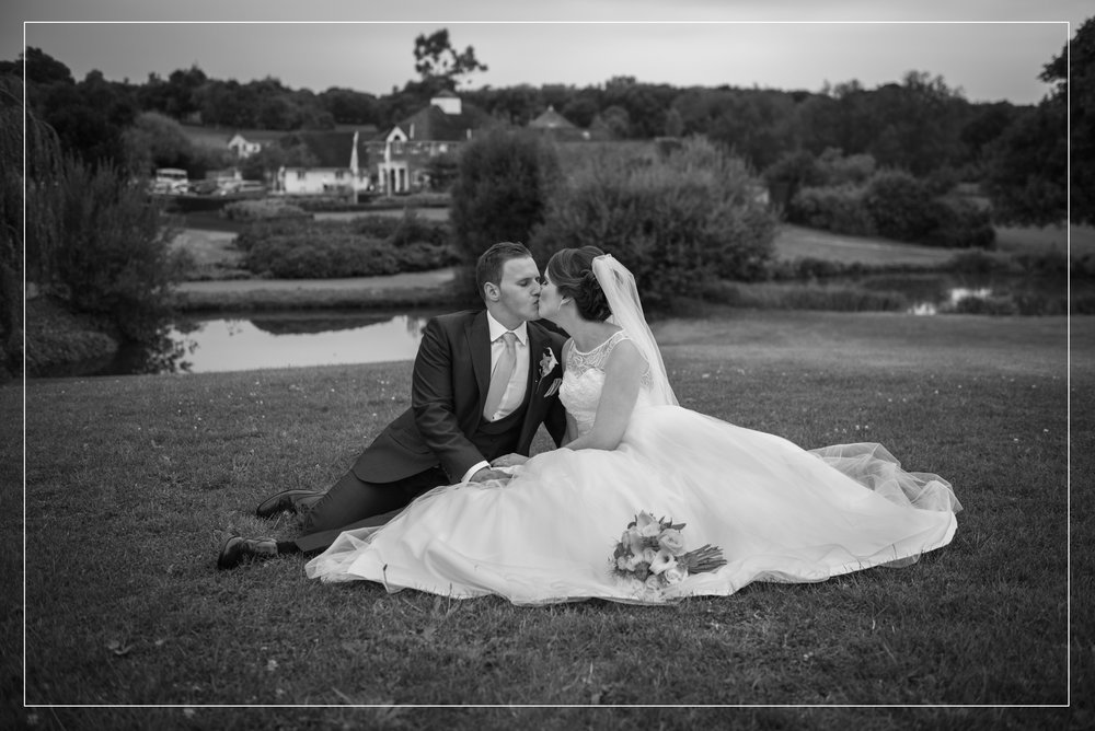 Reading wedding photography at Sandford Springs Golf Club, couple kissing