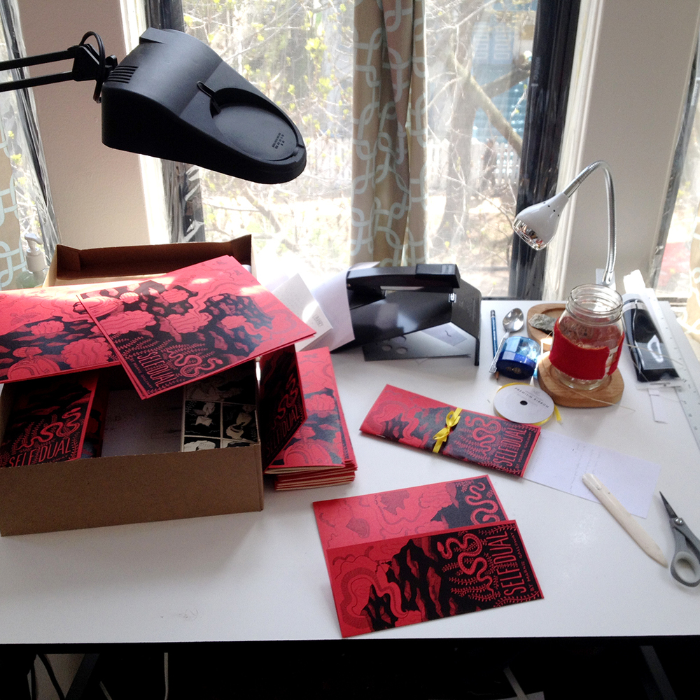 Trimming and folding the body pages, folding the tri-fold cover, and saddle stitching the book, plus tea and audiobooks