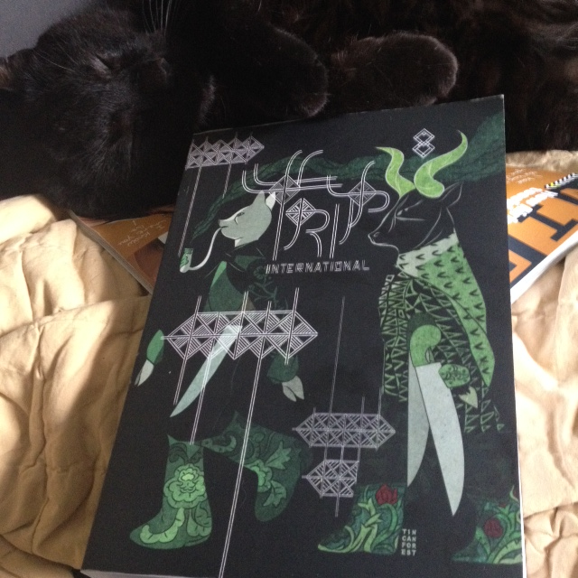 The Great Black Cat enjoys my copy of Trip 8