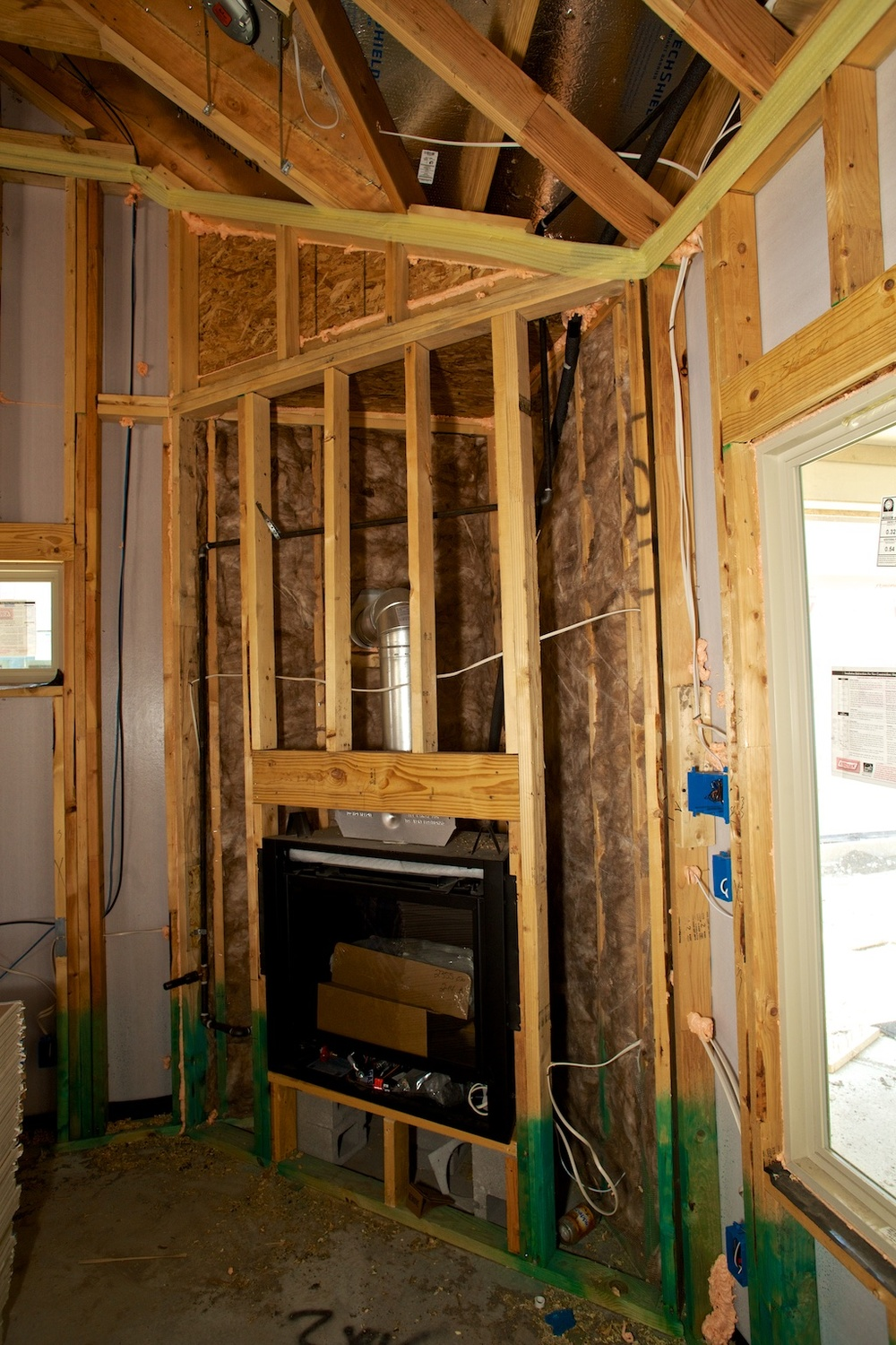 Insulate behind fireplaces.jpg