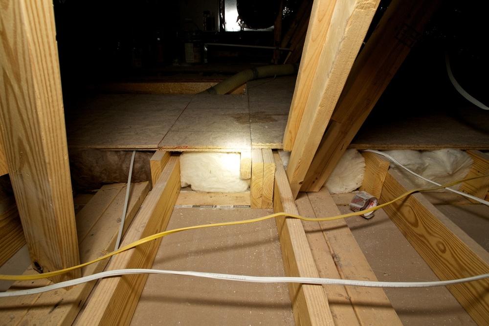 Insulate under attic platforms, but not this way!.jpg