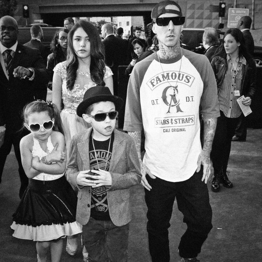 Travis Barker brings his family