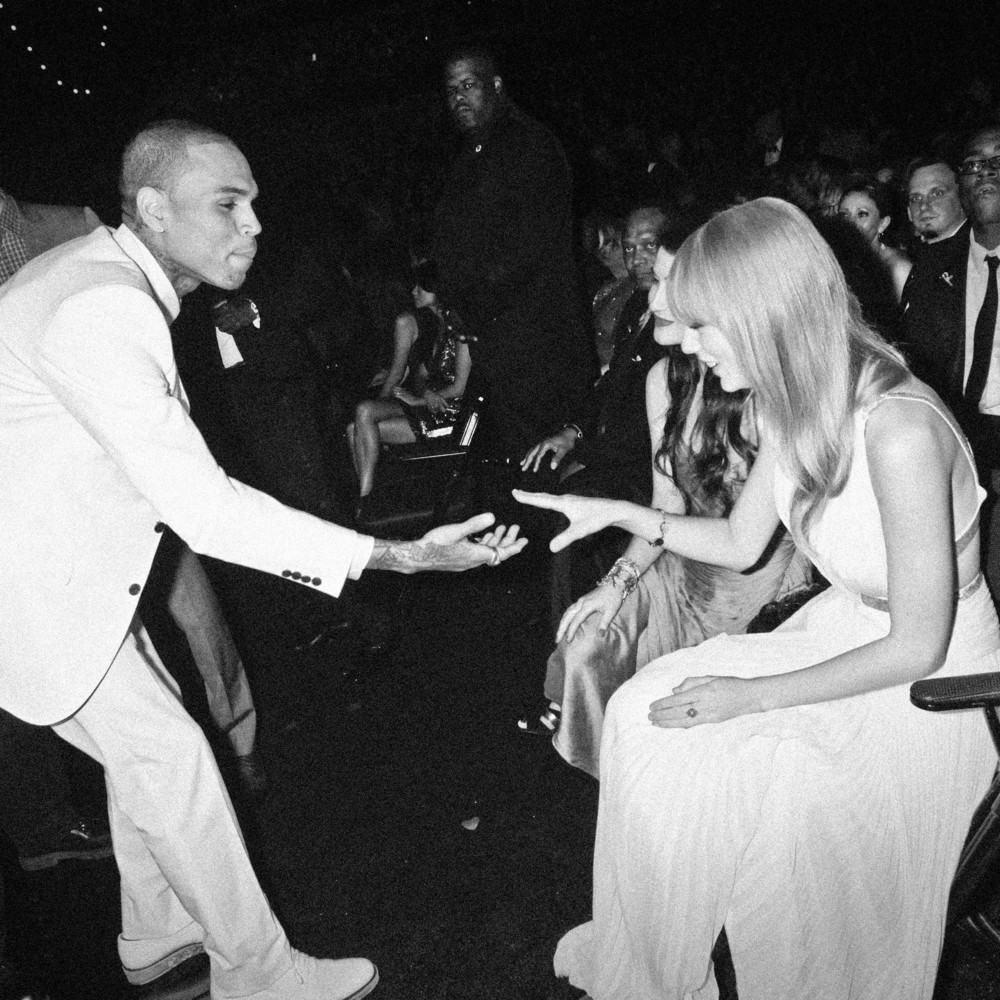 Chris Brown tries to shake Taylor Swift's hand