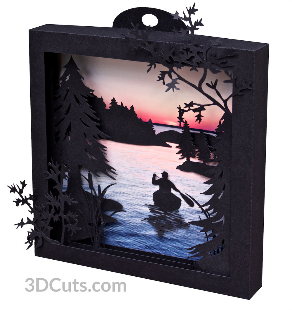 Canoe at Sunrise Shadow Box in paper by Marji Roy of 3dcuts.com. Cutting files in svg, pdf, png and dxf formats for Silhouette and Cricut cutting machines