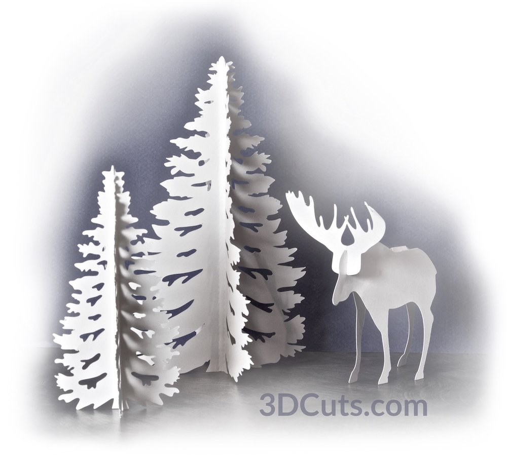 "Create an easy 3D diorama featuring a stately moose standing in the fir trees. This project includes detailed cutting files for simple 3D construction techniques to make this stunning set. It looks wonderful on a mantel or shelf. Finished moose is about 4"" tall. Tall tree is 6.5"" high."