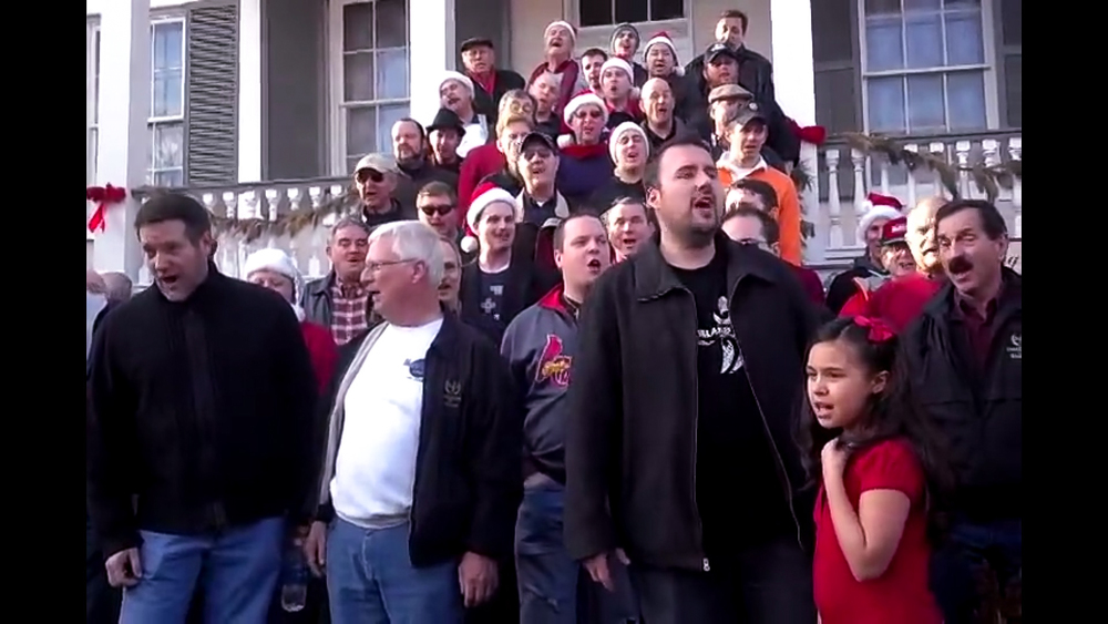 Members of the Ambassadors of Harmony sing along Main Street in St. Charles in December 2012.