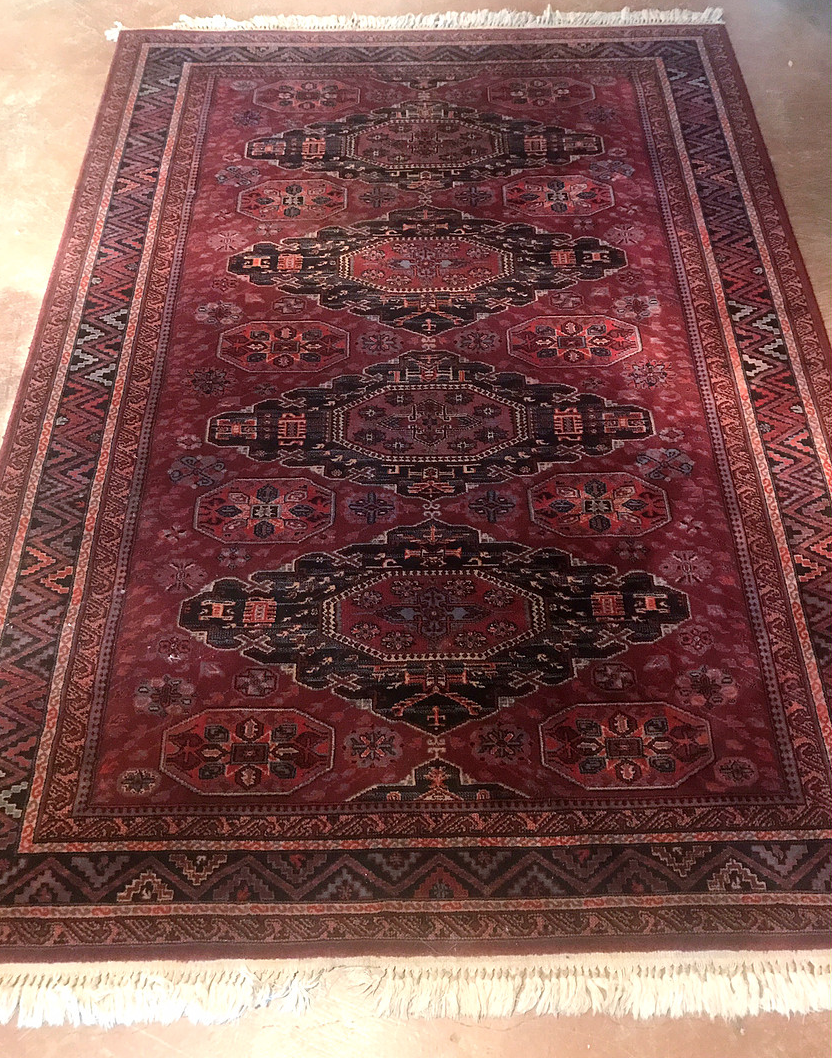 red rug under the table?, could overlap a few rugs...