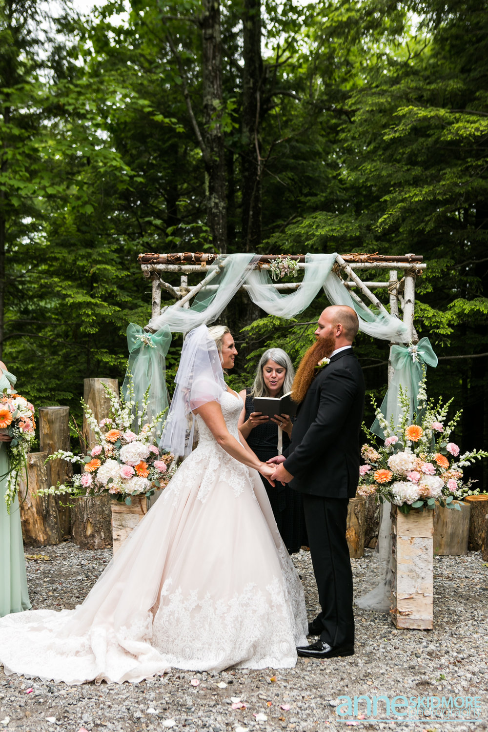 Mark and Barbie say I do at a rustic barn wedding in Norway, Maine officiated by A Sweet Start. Photo by Anne Skidmore Photography