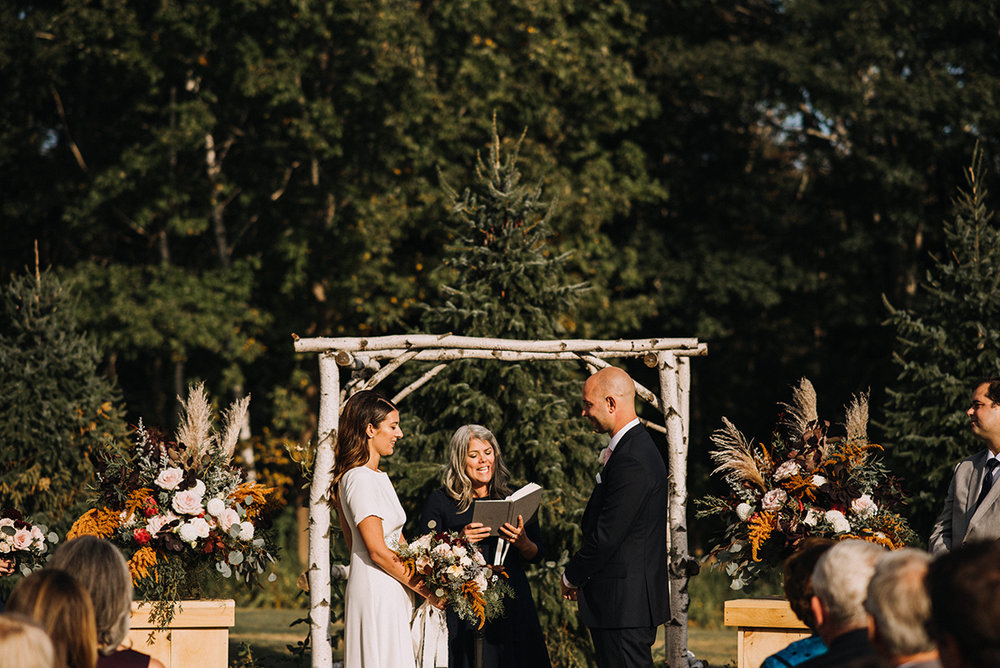 Maine wedding officiant at Live Well Farm | Cortney Vamvakias Photography