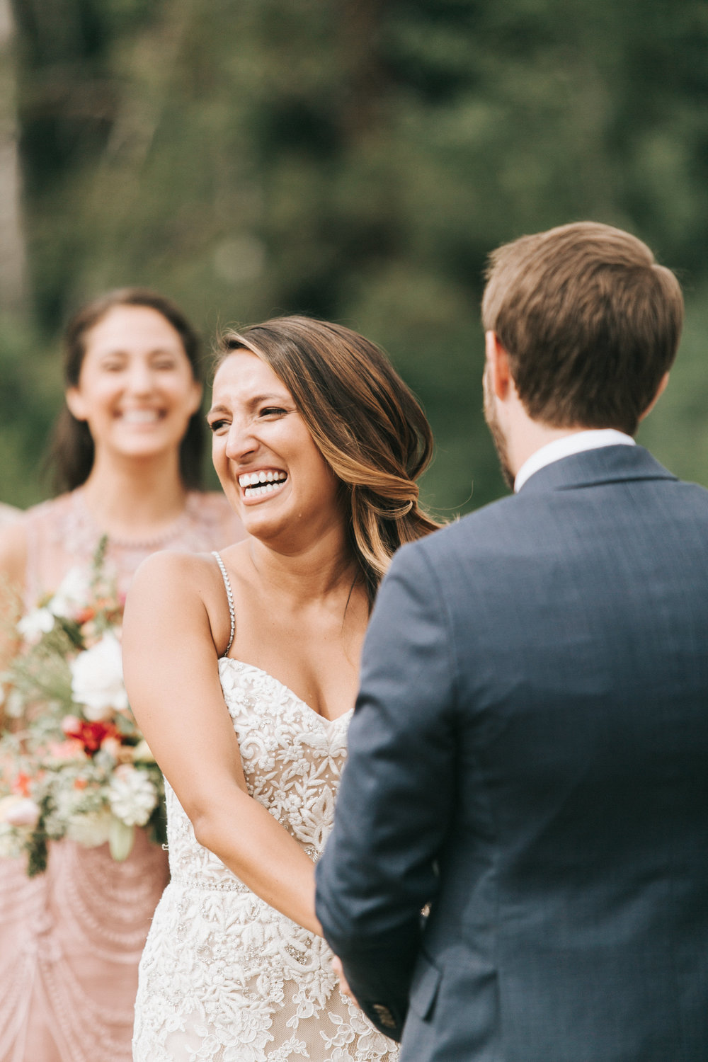 9 Things to Do on Wedding day | Here's Claire looking out at her guests during the ceremony | Photo by  Emily Delamater Photography  Officiated by  A Sweet Start