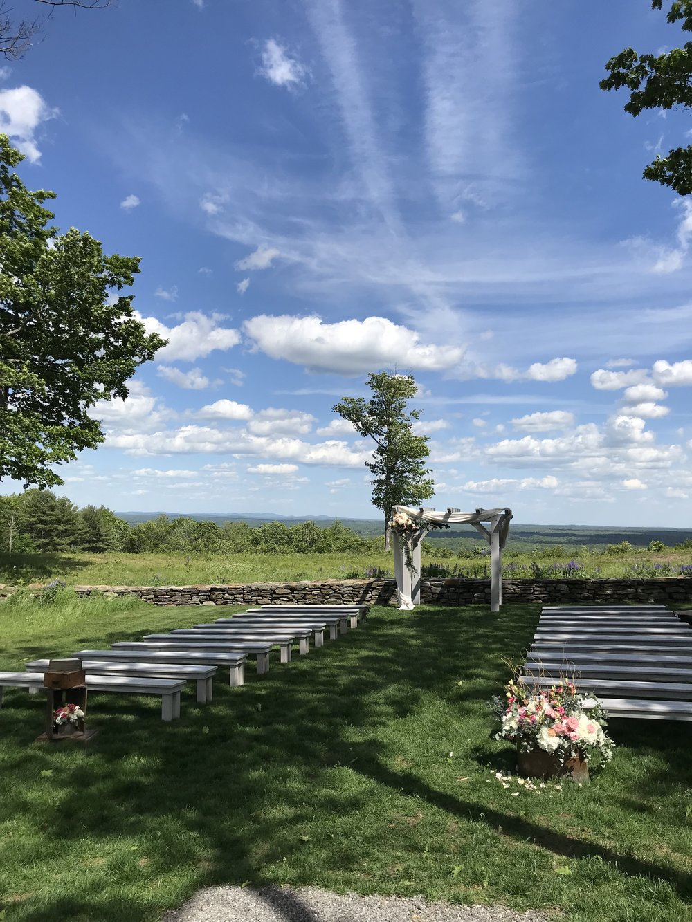 Why are professional wedding officiants so expensive? Photo of the ceremony site at  Beech Hill Barn  in Pittston, Maine by  A Sweet Start