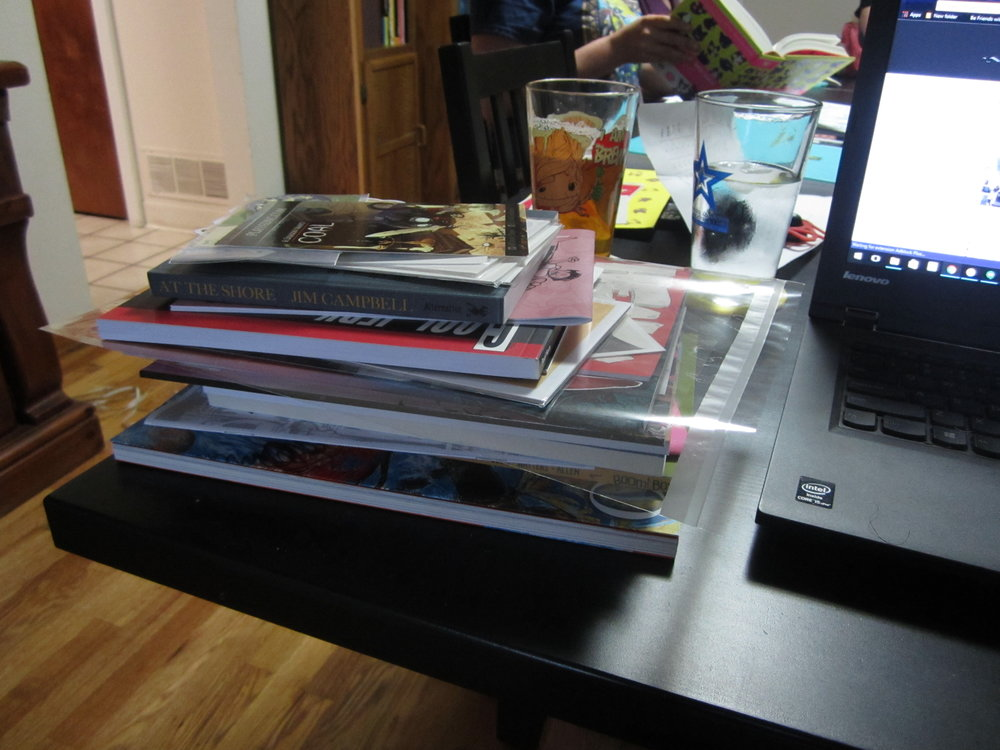 Whew, that's a stack of comics. How long is it going to take me to get through all of these.