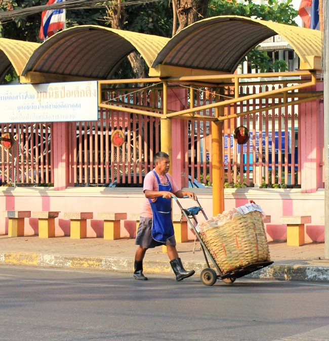 Man heading to the market in Thailand