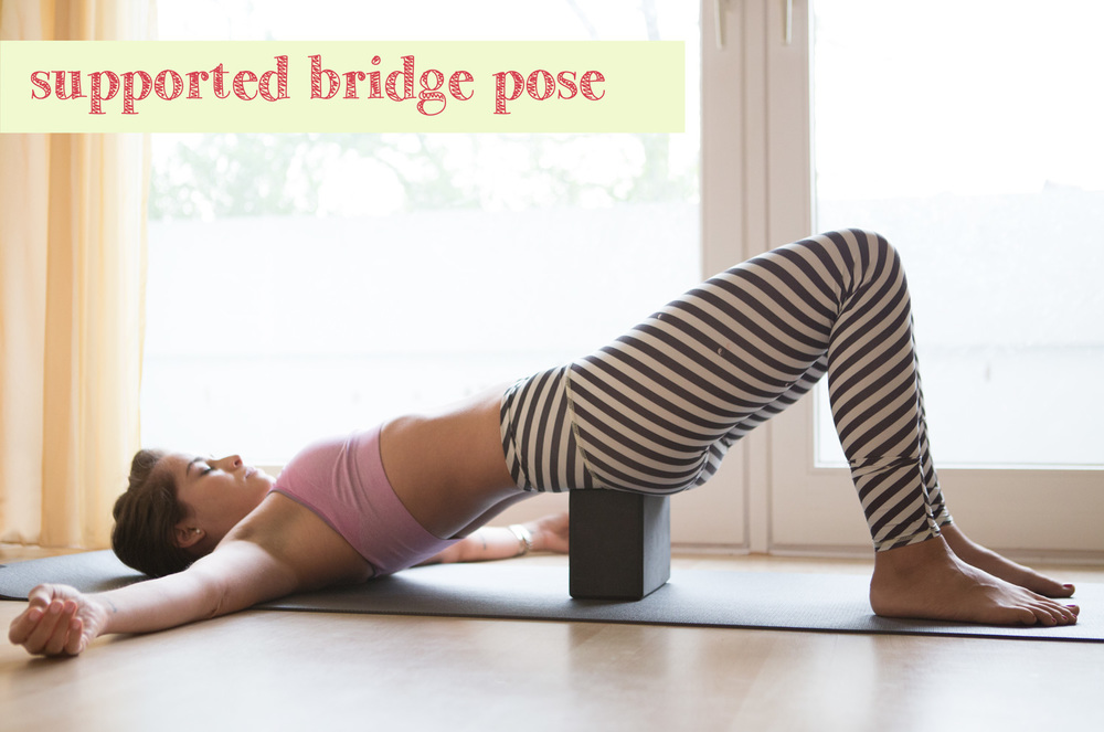 Pin it! Supported bridge pose - a great restorative pose  Wearing: Champion  sports bra ,  Teeki balanced traveler pants . Using:  Wellicious divine mat .