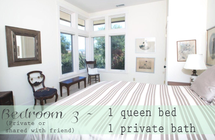 Bedroom three features a queen bed and private bathroom