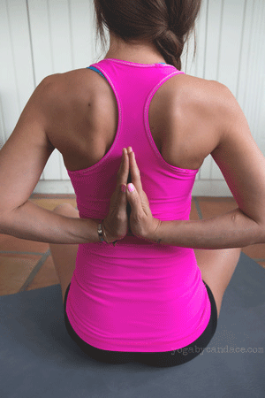 Pin it! Reverse prayer pose Wearing: lululemon top (review) and bottoms, Using Eko-Lite Manduka mat.