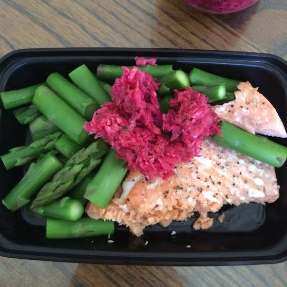 A meal in one of the ISO Bag containers. Asparagus, salmon and fermented red cabbage.