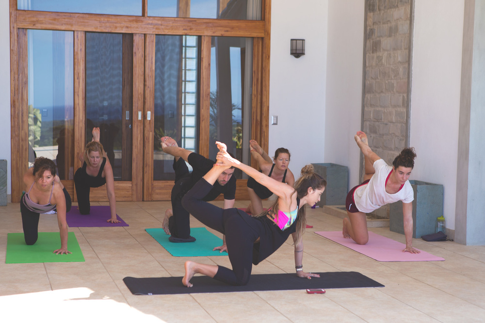 Yoga class at the retreat  Wearing:  zobha mesh insert pants  - super high quality and comfortable!,  onzie tank ,  onzie bra .