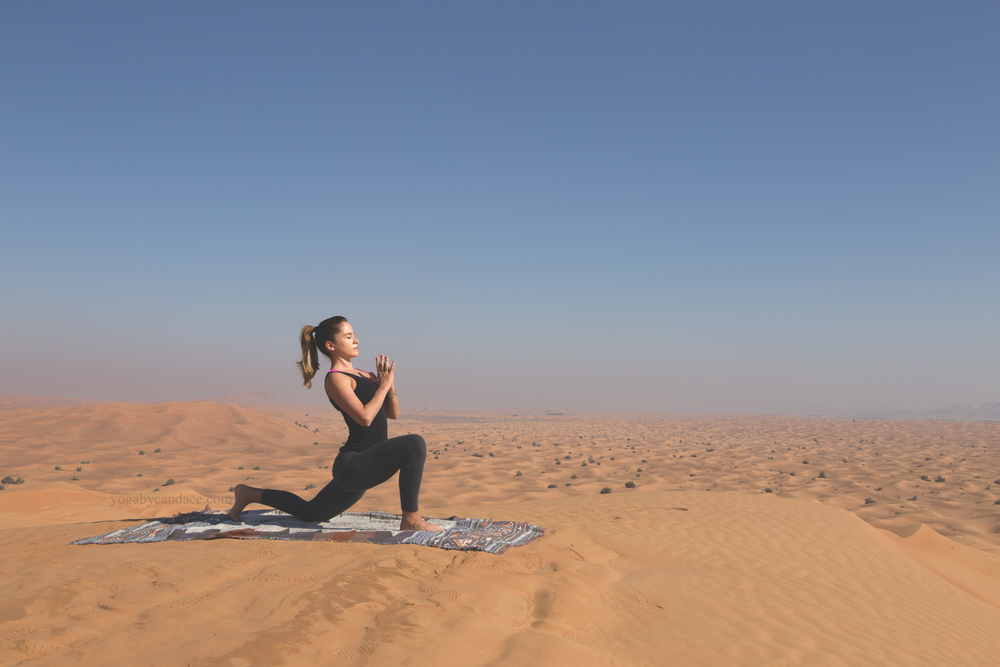 Low lunge in the Arabian desert  Wearing:  forever 21 leggings ,  splendid tank .