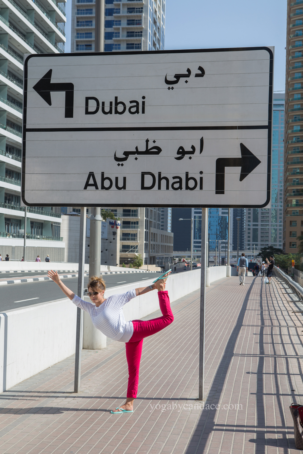Yoga in Dubai Wearing: sunglasses, j brand pants, hard tail top (diff color).