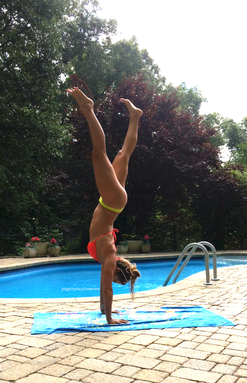 Handstand by the pool  Wearing:  bathing suit top  (now on sale!), Gypsea Swimwear bottoms ( similar ).