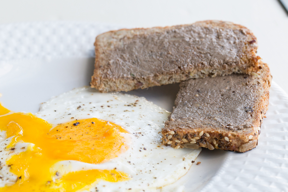 Liver pate on toast with an egg.
