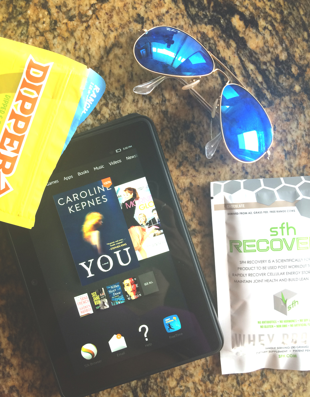 Essentials: sunglasses,  whey protein , kindle (just read  this book  - INSANE),  dipperz