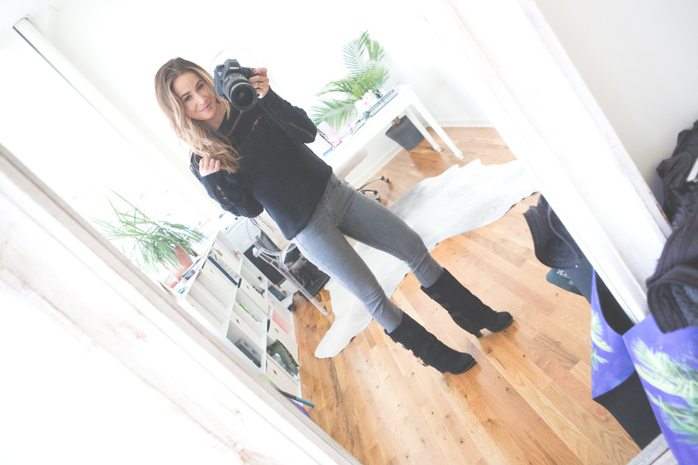 Off the mat  Wearing:  Ramy Brook sweater  c/o,  j brand jeans , report boots (old)