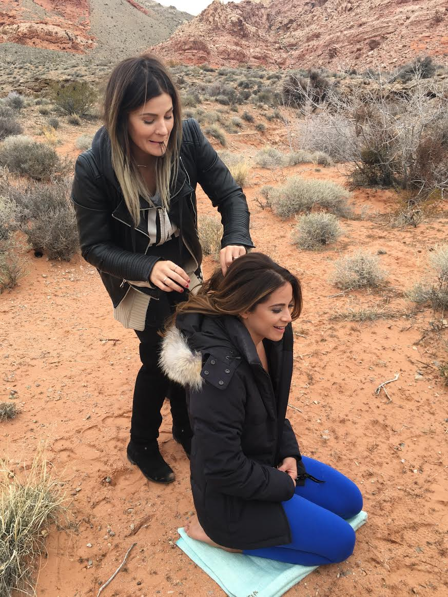 Whitney VanOsdol doing my hair  Yoga blanket from , coat by Canada Goose.