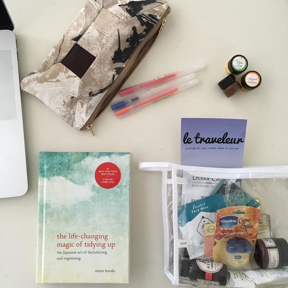 On my desk: artists' wallet from Mizu, Muji pens (the best pens ever),  Earthwise Beauty samples, Le Traveleur essentials, The Life-Changing Magic of Tidying Up.