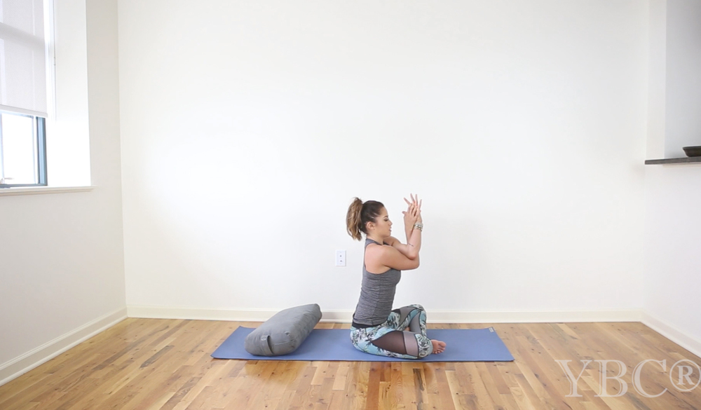 15 Minute gentle yoga for neck and shoulders  Wearing:  Sweaty Betty top  and  pants . Using:  Manduka bolster ,  Jade yoga mat .