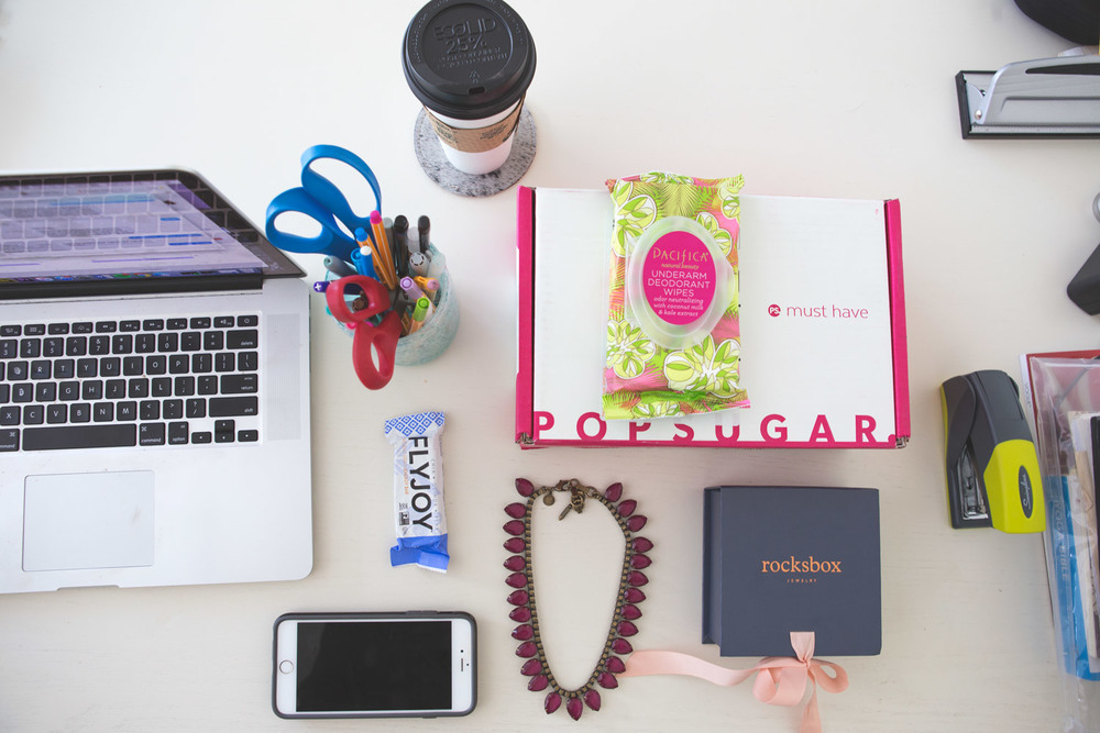 On my desk - popsugar must have box, rocksbox, flyjoy, cawfee :)